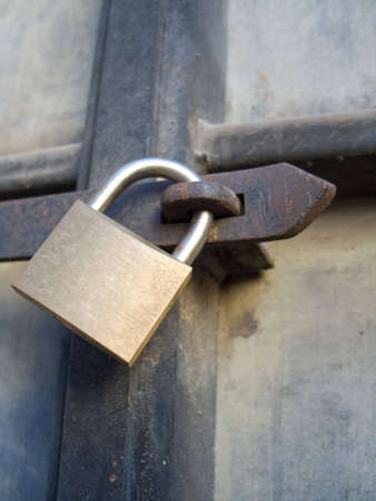 Padlock on old rusty door Stock Photo - 4233570