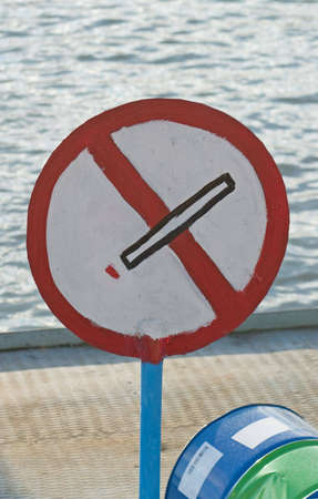 crossed cigarette: No-smoking sign on industrial cargo ship