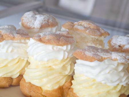 Cream puffs closeup photo