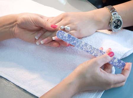 french manicure sexy woman: Nail file work Stock Photo