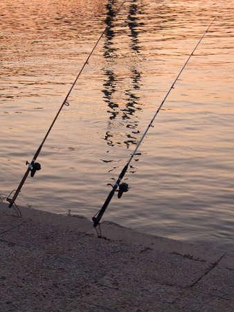 fishingline: Two fishing rods Stock Photo