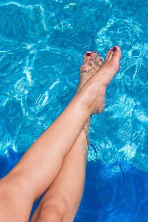girl legs: Sexy girl legs on the edge of swimming pool