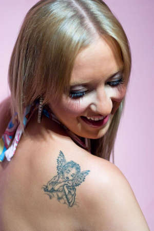 Blond girl with tattoo photo