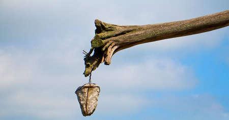 joist: Stone hanging on rotten joist