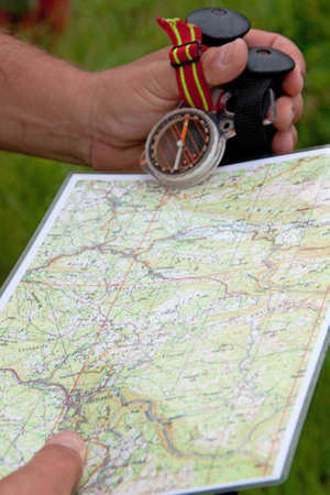 Hikier holding map and compass Stock Photo - 10172496