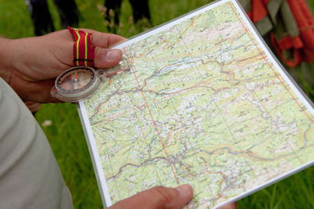 orienteering: Hikier holding map and compass