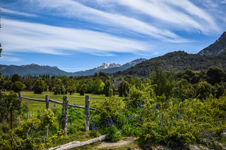 Spring Landscape with blue sky and clouds with background of mountains in Lake Gutierrez, Bariloche, Argentina.