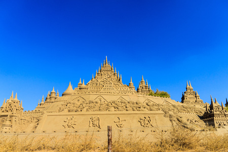 sand sculpture under the blue sky