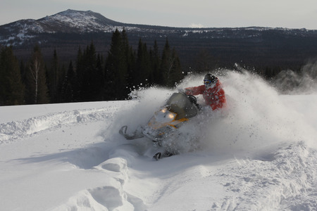 Sportsman on snowmobile