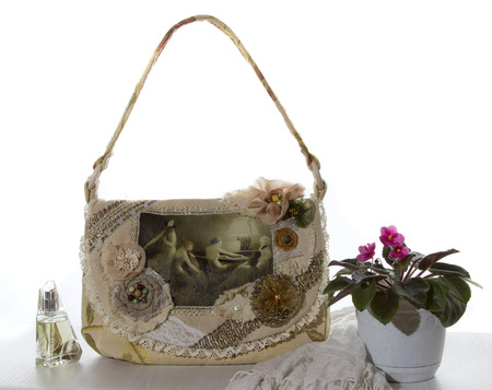 Bag in the style of boho with white scarf and violet photo