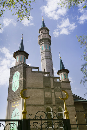 madina: Madina Mosque on a background of blue sky with clouds.  Russia. Ufa Stock Photo