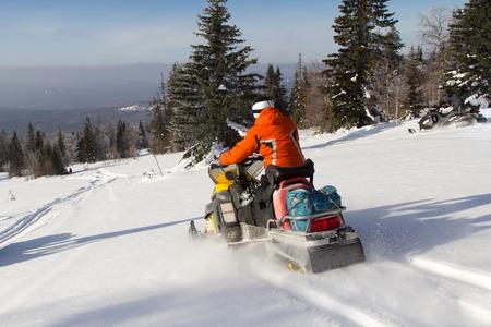 Man on snow mobile