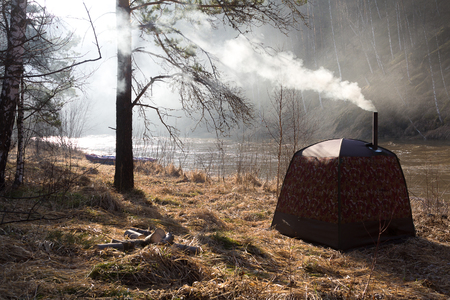 stove pipe: Hiking sauna on the banks of the river Inzer. Spring morning in Bashkiria.