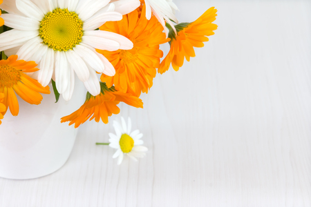 Bouquet Of Daisies Cornflowers Calendula In A White Vase On