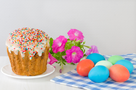 Easter eggs and Easter cake on a light background. Stock Photo