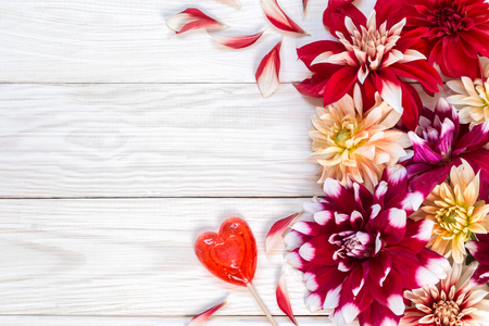 Bright dahlias on a wooden background. Copy and paste.