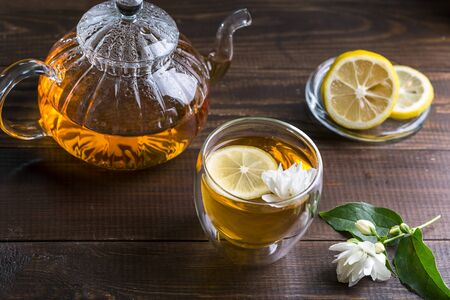 Jasmine tea in a cup on a wooden background. Stok Fotoğraf
