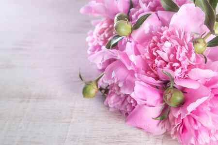 Bouquet of pink peonies  on a wooden table. Gift Valentines Day.