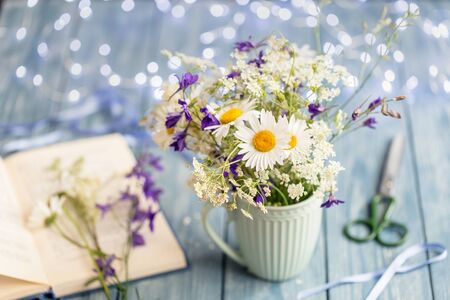 Bouquet of wild flowers on wooden background. Stok Fotoğraf