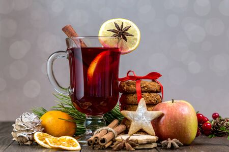 Christmas mulled wine and tangerines on a wooden background. Stock Photo