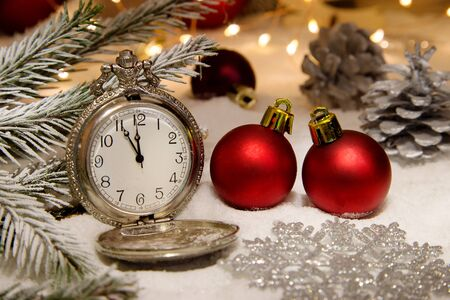 Vintage clock with christmas decorations and lights