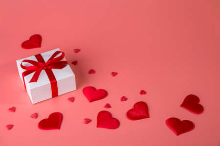 Valentine's day background with red hearts and gift. Copy space.