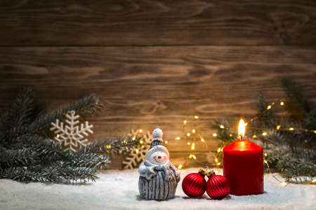 Christmas card with a garland and Christmas decorations. Copy space.