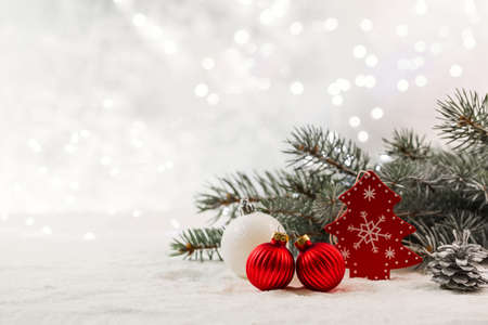 Christmas card with fir branches and Christmas decorations. Copy space. Stock Photo