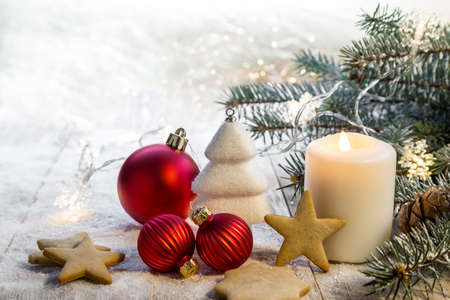 Christmas candle on rustic wooden boards - decoration with natural elements, twigs, pine cones, Christmas decorations. Copy space.