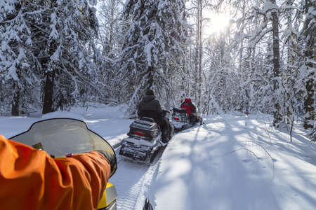 Snowmobiling in the Urals mountains on a frosty day. Stock Photo