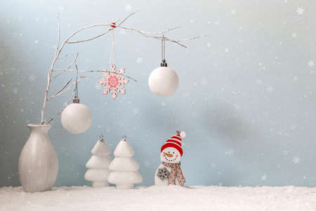 Christmas card with a snowman and Christmas decorations. Copy space.