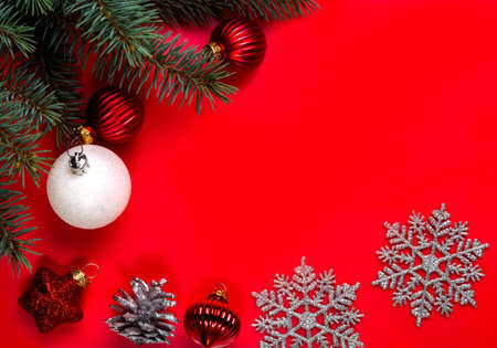 Christmas decorations lying on a red background. Copy space.