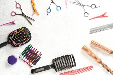 Set of accessories for a beauty salon on a light background copy space top view.