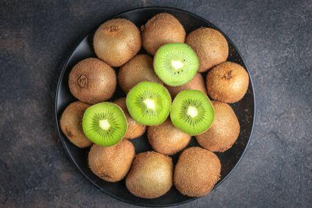 Fresh ripe kiwi fruit on  a dark  background. Detox diet. Copy space.