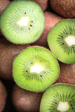 Ripe fresh kiwi fruit as background Stock Photo