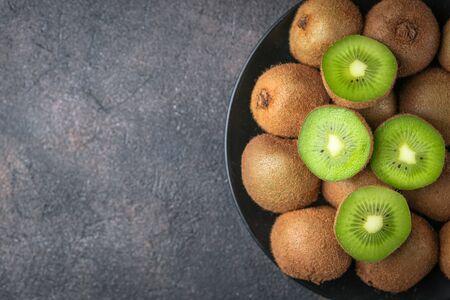 Fresh ripe kiwi fruit on  a dark  background. Detox diet. Copy space. Top view. Stock Photo