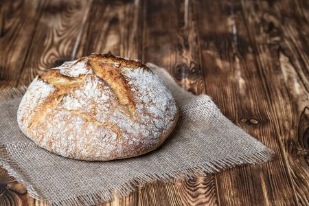 Delicious homemade bread on a napkin on rustic background. 版權商用圖片