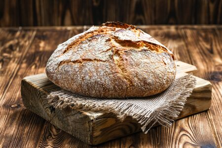 Delicious homemade bread on a napkin on rustic background.