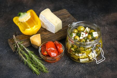 Set of products for a Mediterranean breakfast: olives, bread, cheeses, herbs and vegetables. Healthly food. 版權商用圖片