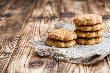 Homemade corn cookies on a rustic background. Copy space.