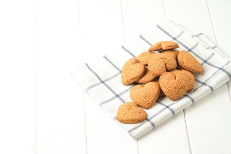 Ginger cookie on a light napkin on a light background top view copy space. 版權商用圖片