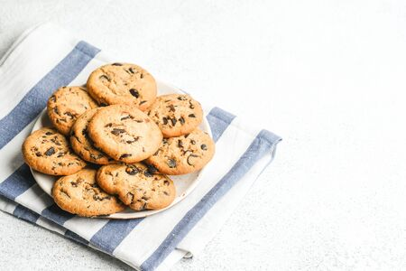 Cookies with chocolate on napkin on light background copy space. 版權商用圖片