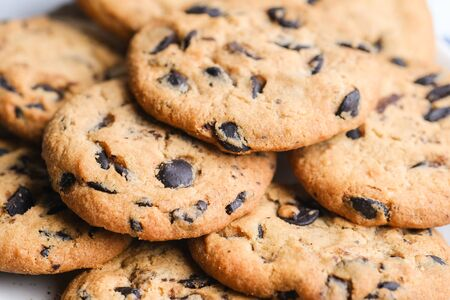Cookies with chocolate on rustic background close-up.