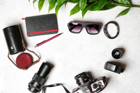 Set of photo accessories with a retro camera on a light background.Travel vacation concept. Summer background. Top view copy space.