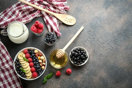 Oatmeal with berries and fruits on a light background. Healthy breakfast.