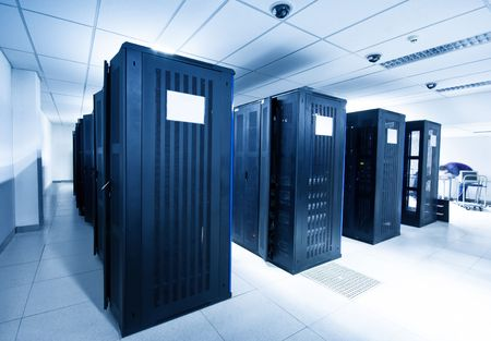 computer centre: A server room with black servers Stock Photo