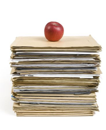 File Stack and red apple close up shot on white background Stock Photo - 6822628