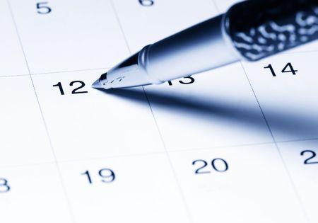 Kalender met pen Stockfoto