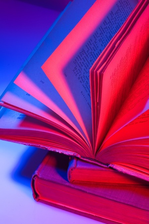 Pile of books with open one Stock Photo - 17384863