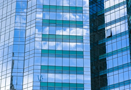 rise and shine: Highrise glass building with sky and clouds reflection